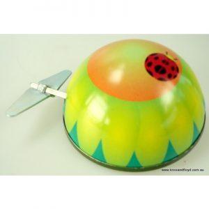 Tin toy - windup Little ladybug on flower